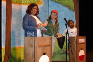 "Fishin' Magician Amy Short emcees the quiz show ""Bobberama."""